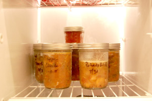 Jars of frozen soup in freezer